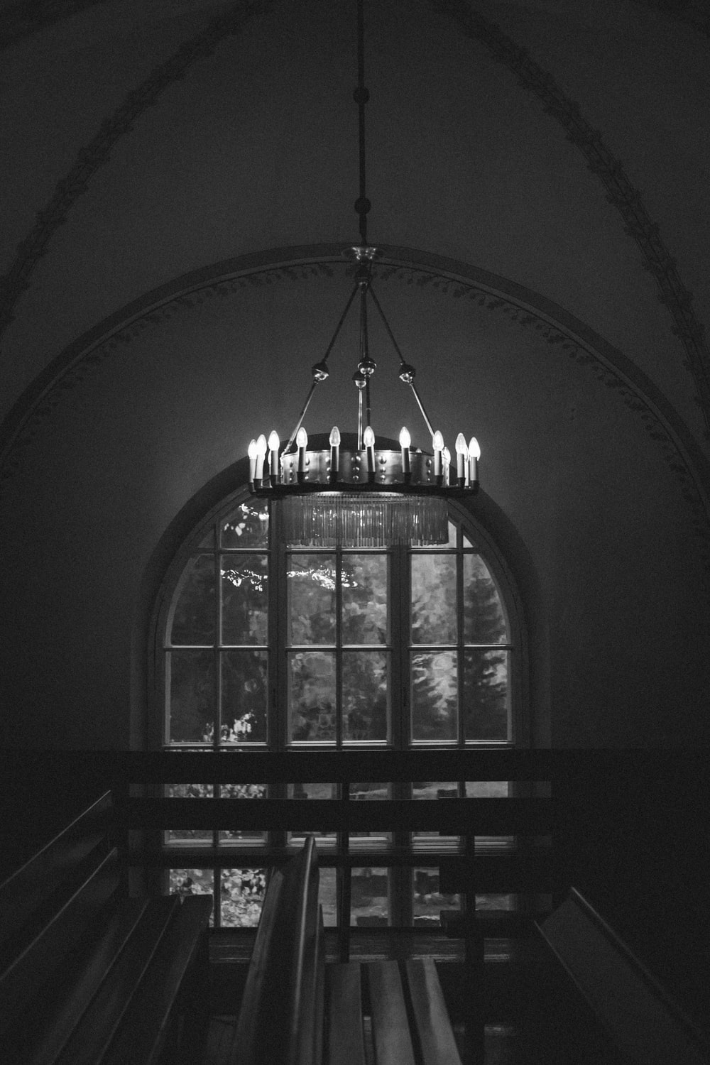grayscale photo of ceiling lamp
