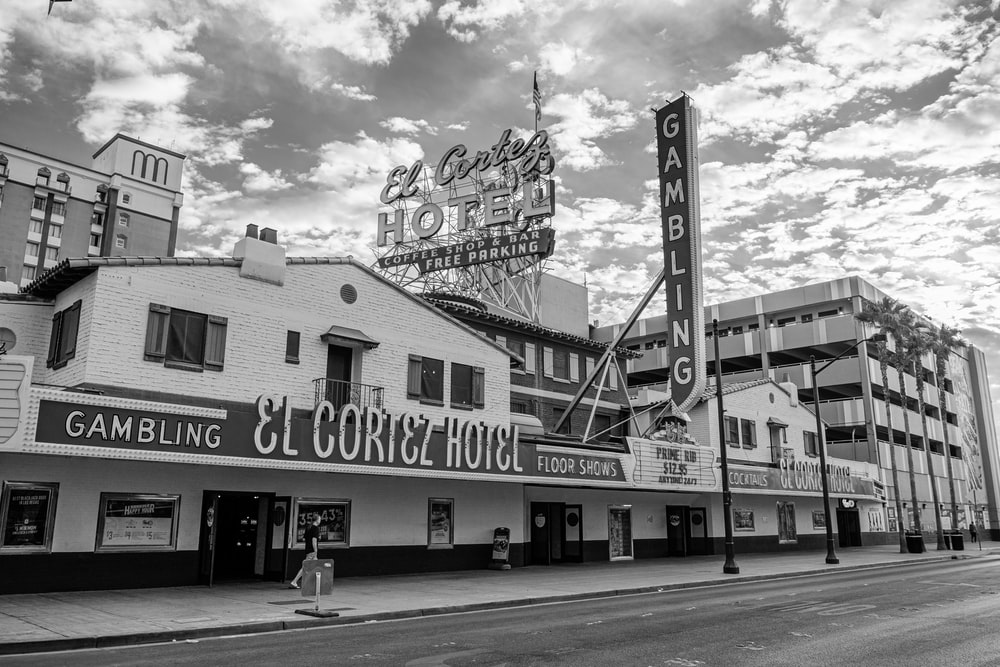 grayscale photography of El Cortez hotel beside road way