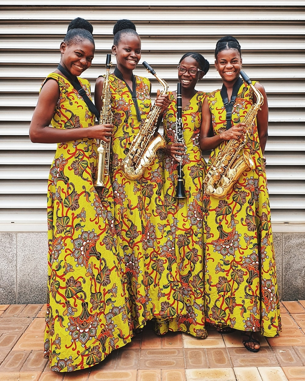 four women playing wind instrument