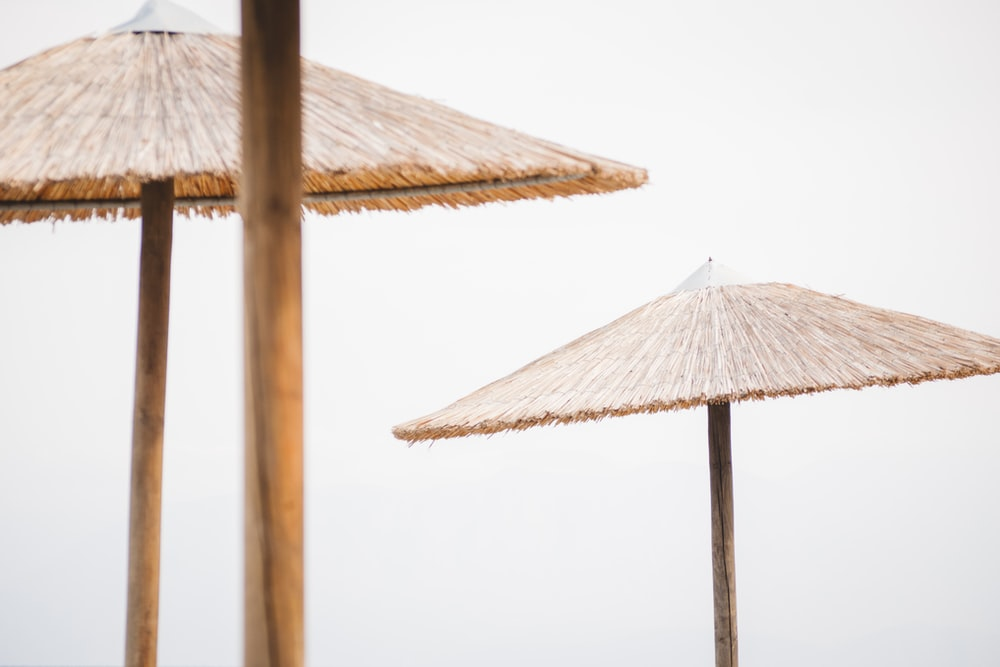 two brown tiki umbrellas