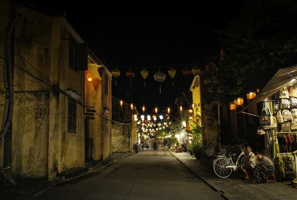 buntings hanging between buildings during nighttime