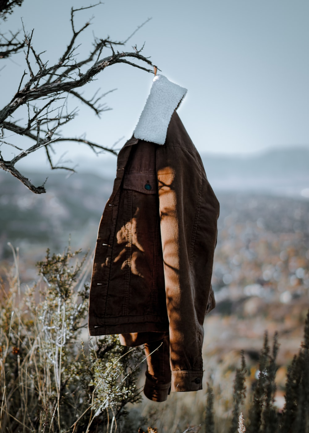 shallow focus photo of brown jacket