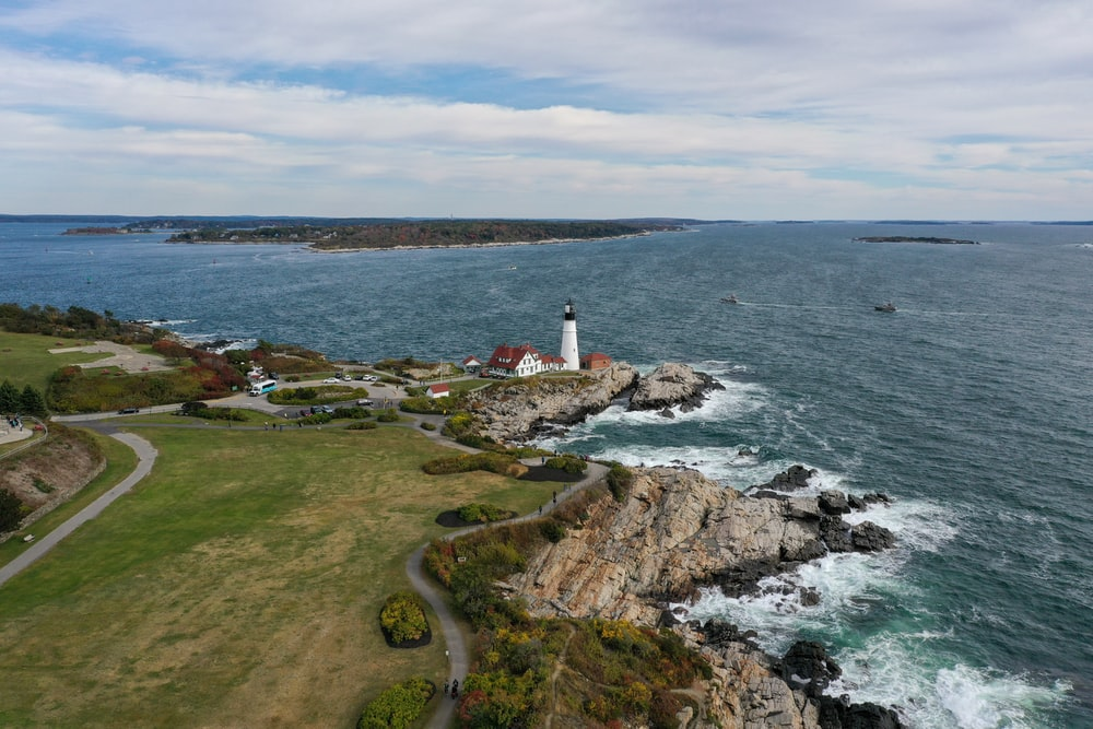 aerial photography of lighthouse by the sea