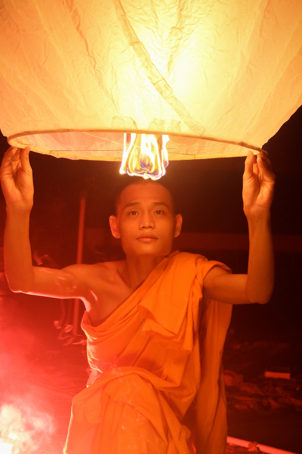 man holding on a paper lantern