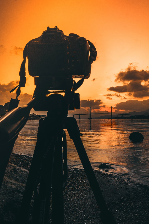 silhouette photo of DSLR camera