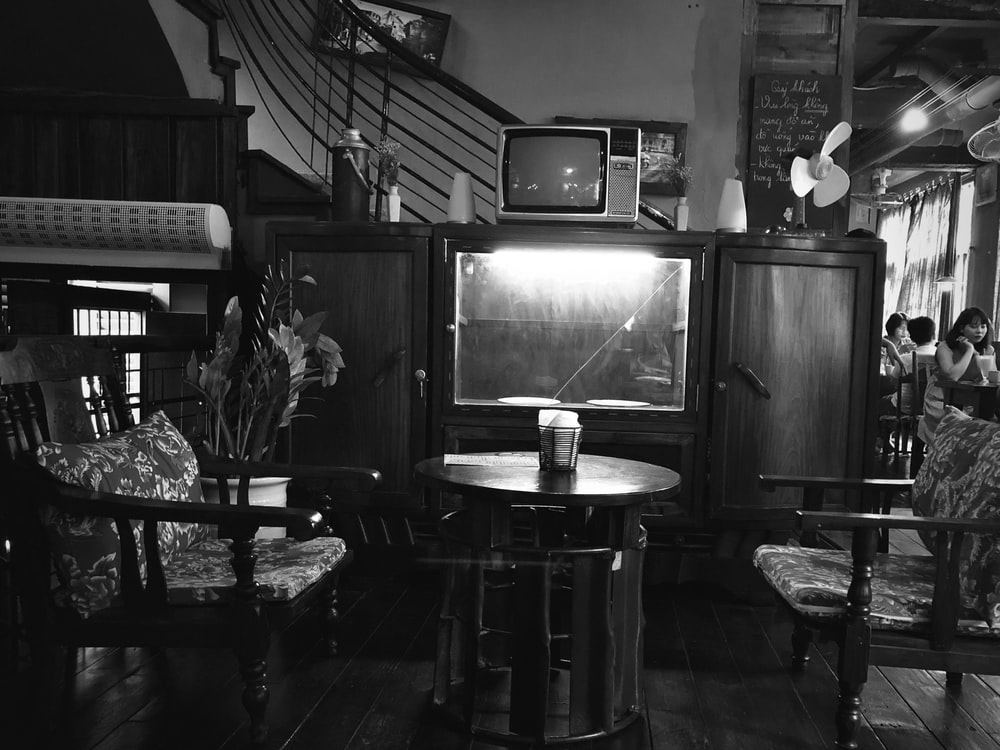 grayscale photography of TV hutch
