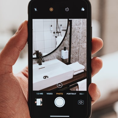 Phone taking a picture of a sink