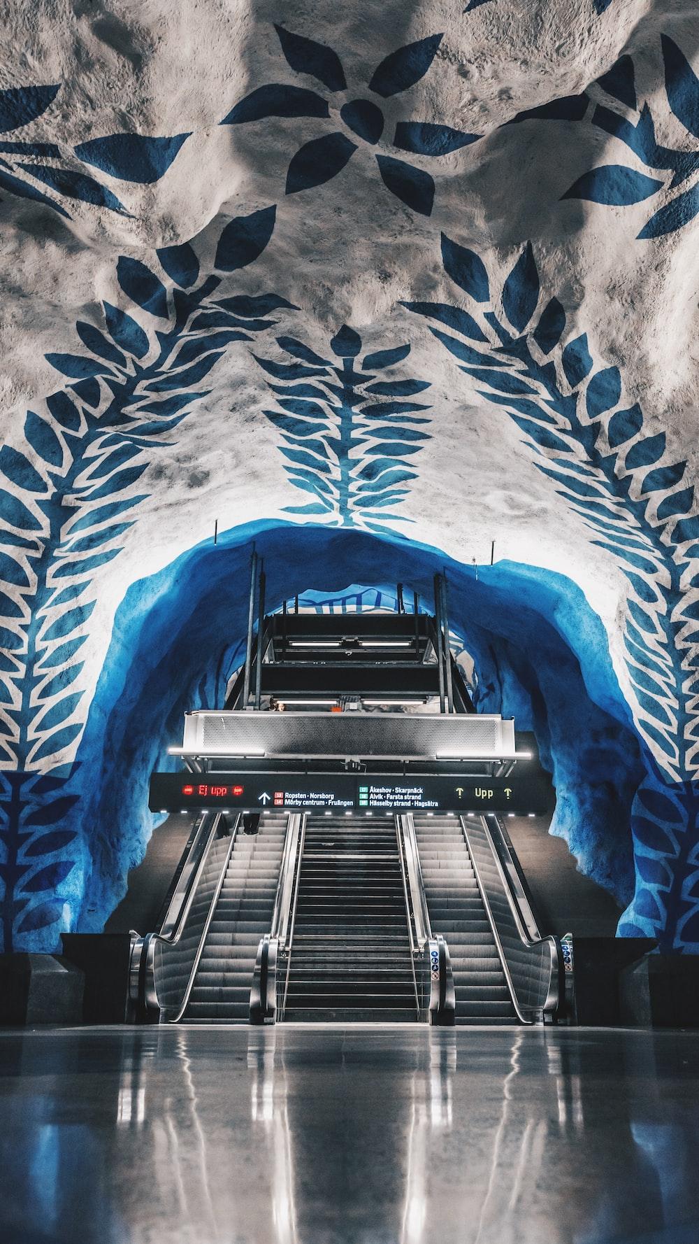 grey escalator inside building