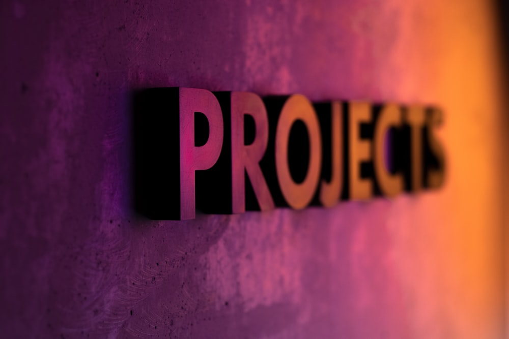 Projects text on pink and orange