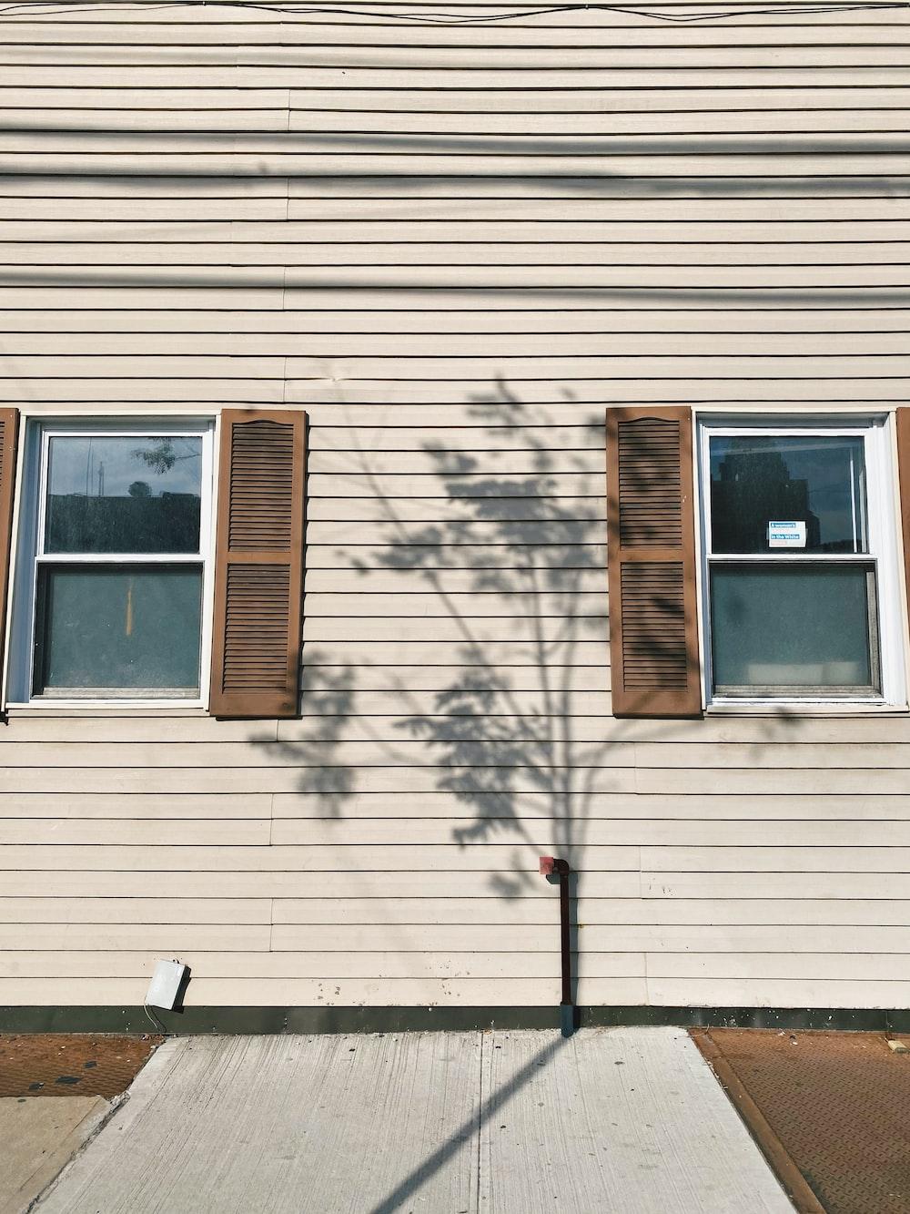 beige wooden house