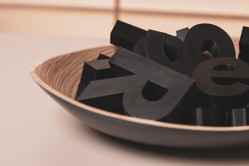 black plastic letters on a brown bowl