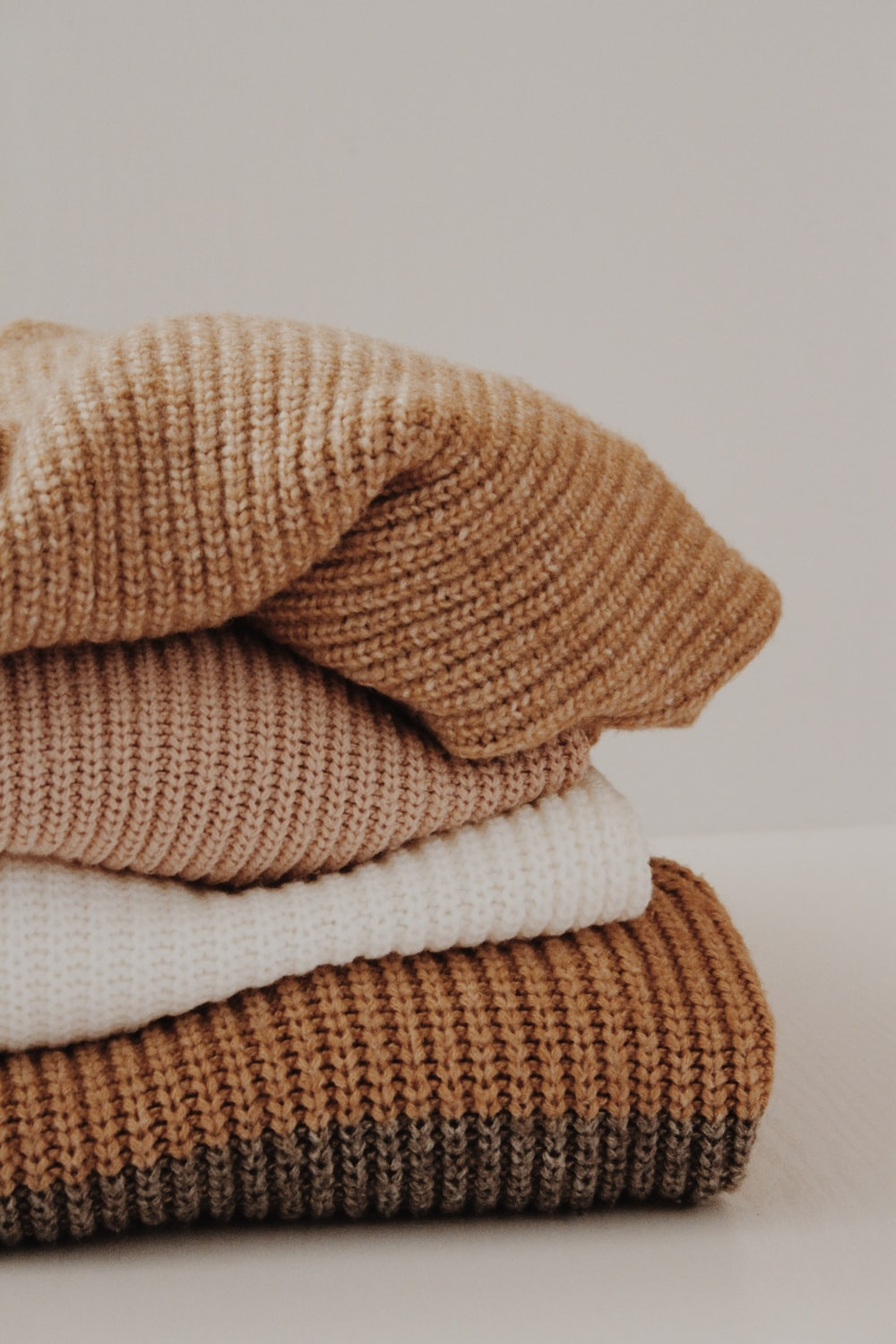 brown and white textiles