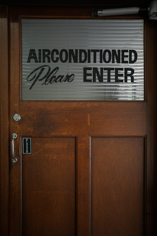 brown glass-panel wooden door
