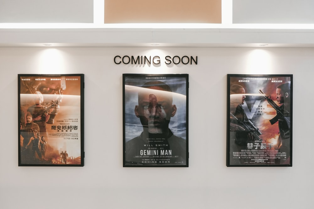 three assorted-title movie posters