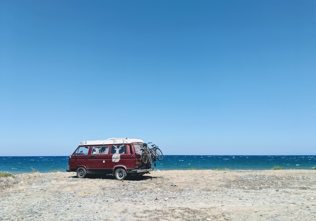 Camping in a Volkswagen Westfalia Camper on a beach in Greece