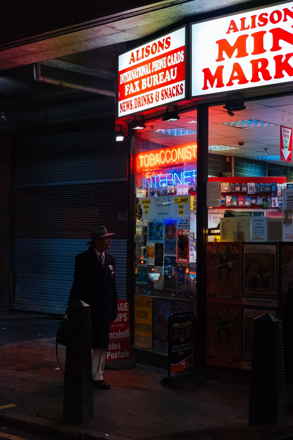 man standing in front of Alisons store