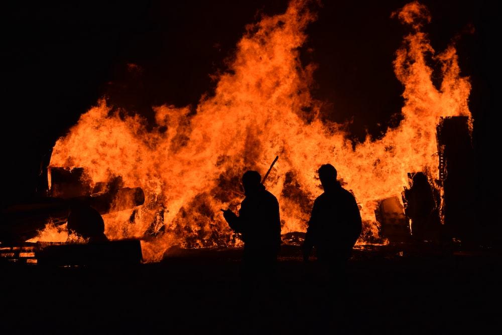 people walking near fire