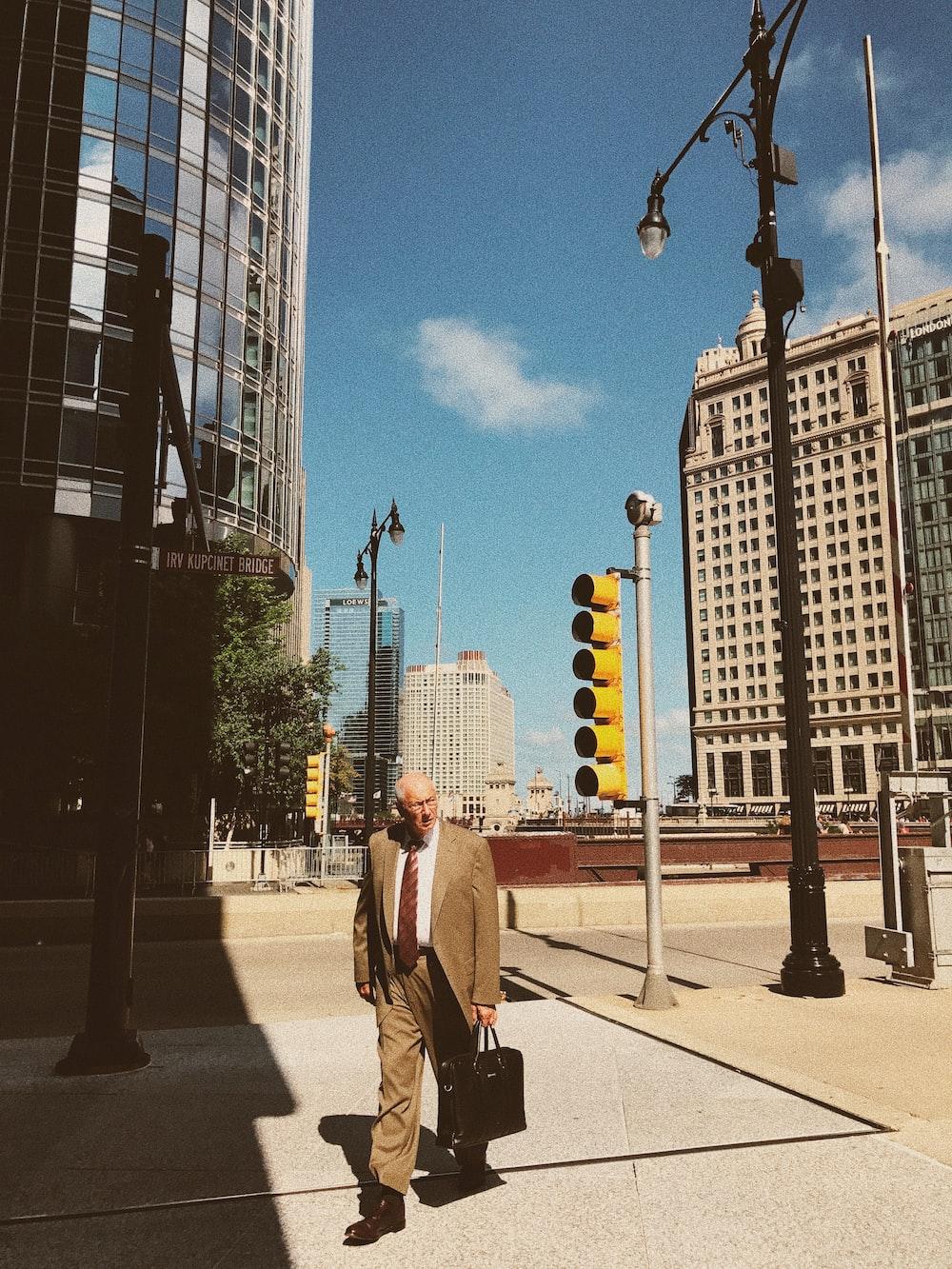 man walking near buildings during daytime