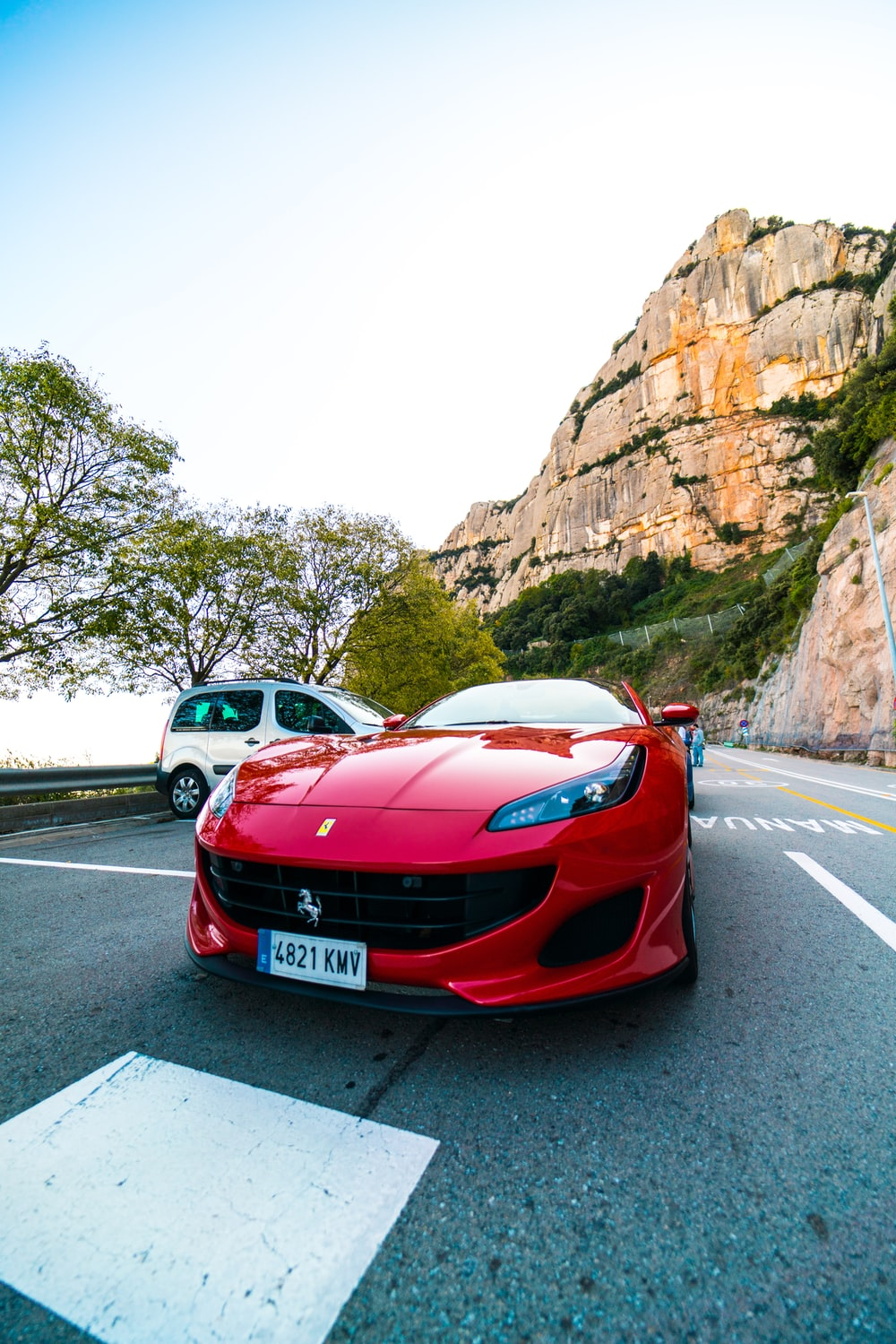 red coupe near mountain