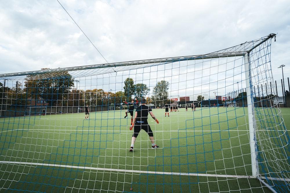 men playing soccer on field
