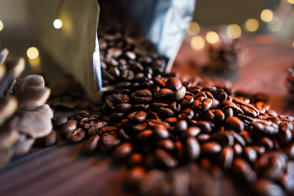black coffee beans on brown surface