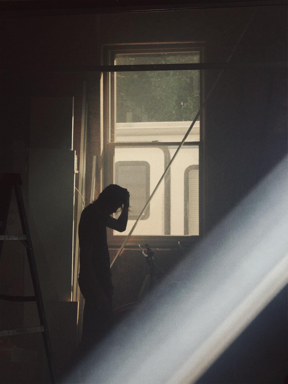man by a window
