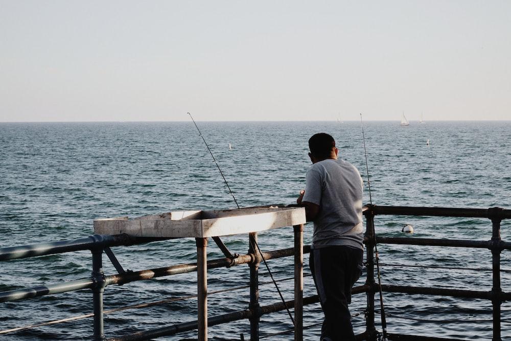 man fishing at a dock