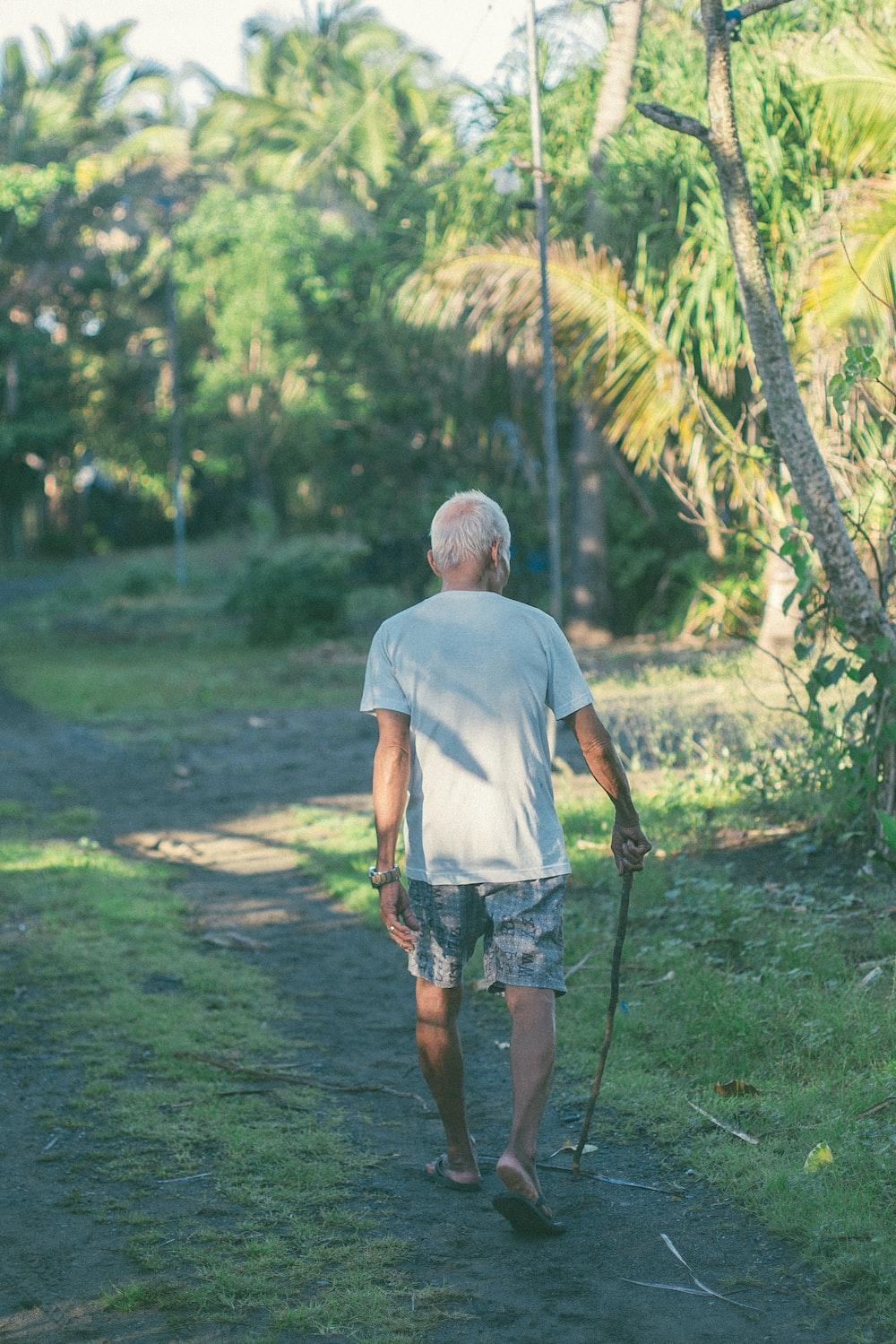 man walking with stick