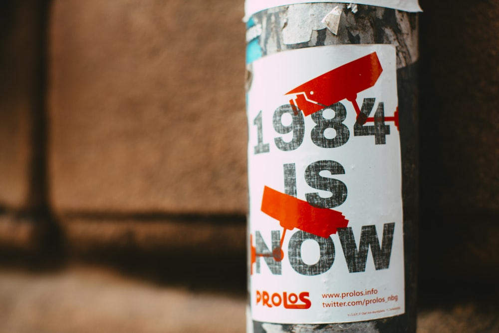 1984 Is Now Prolos bottle on brown surface