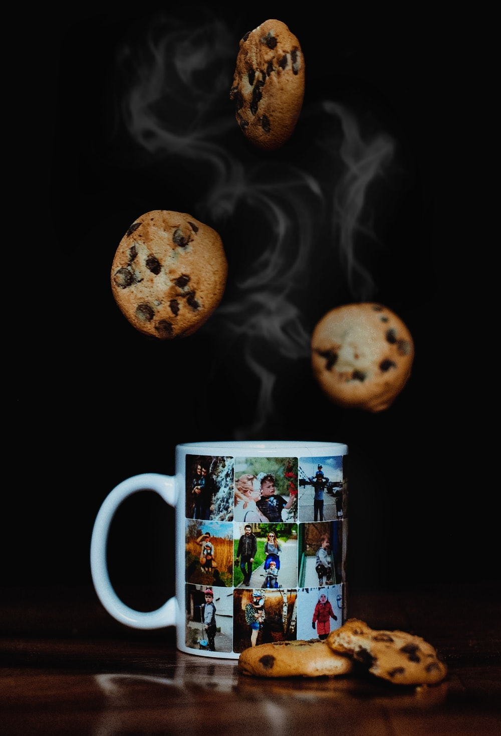 ceramic mug on brown surface with cookies