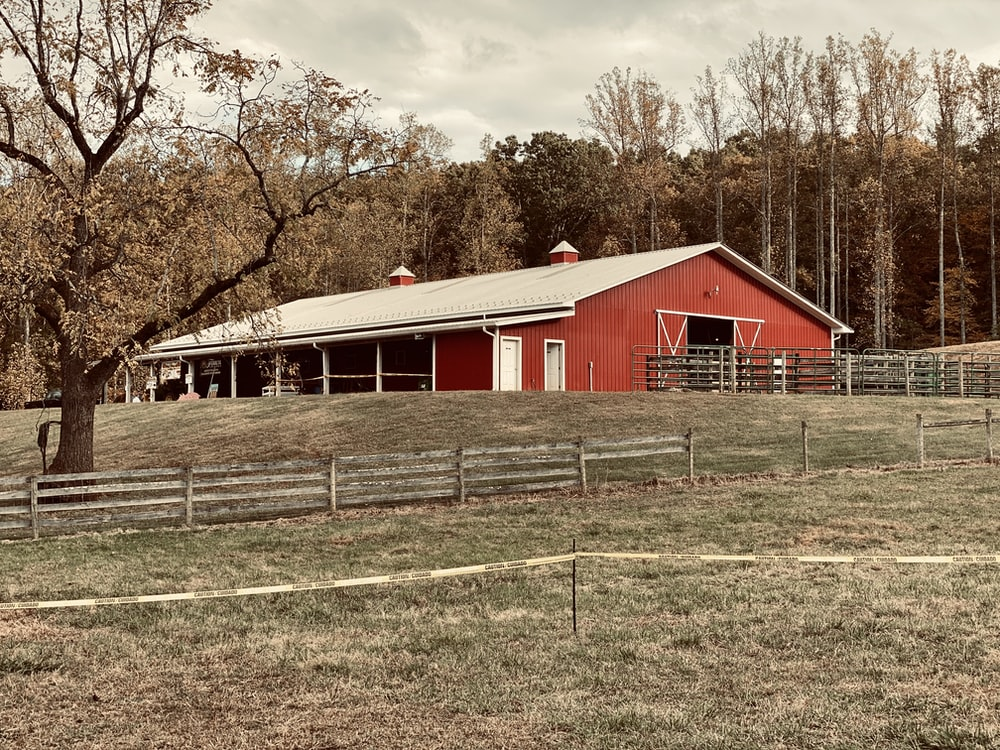 photo of red and white barn house