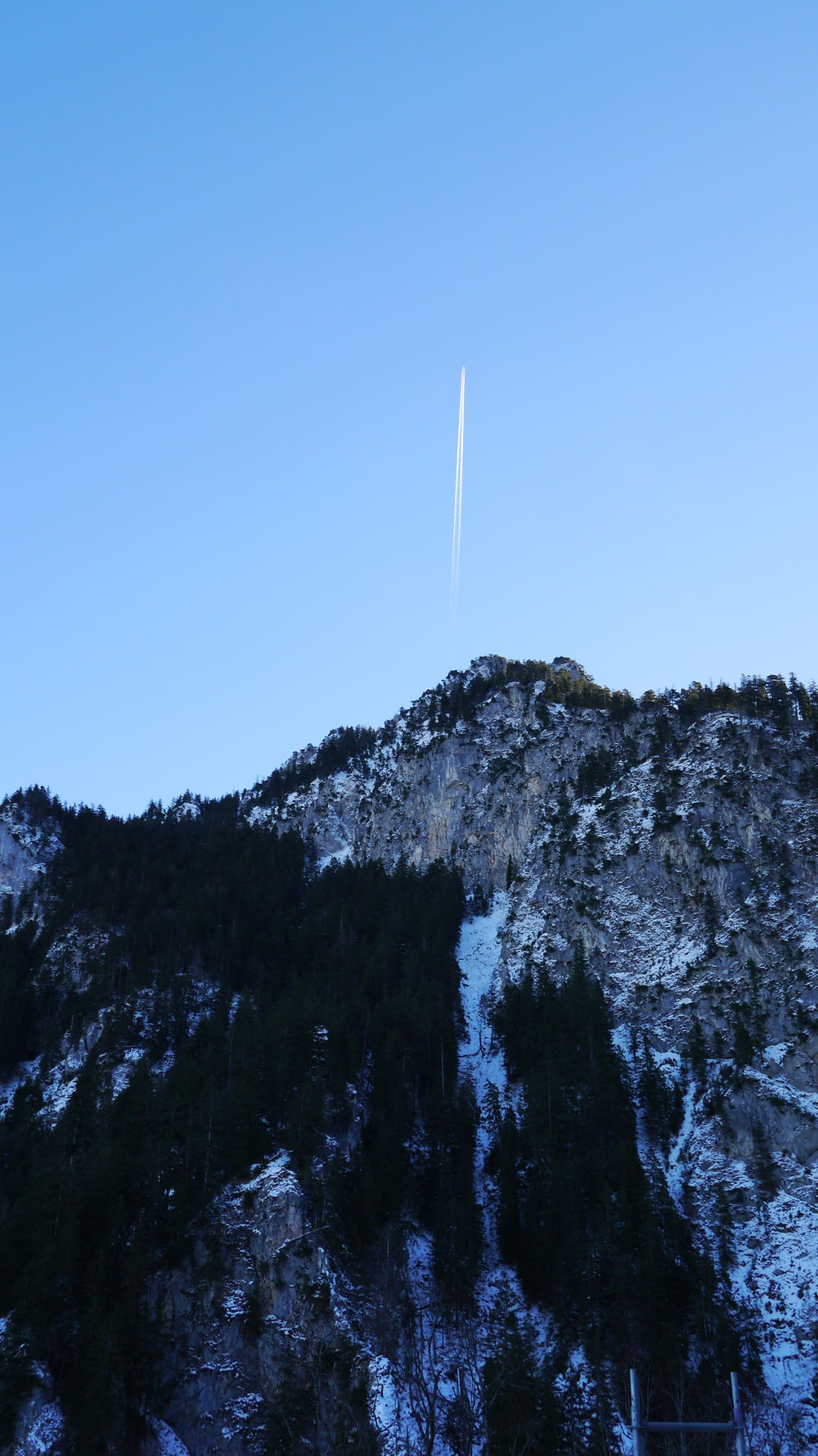 smoke trail above the mountain