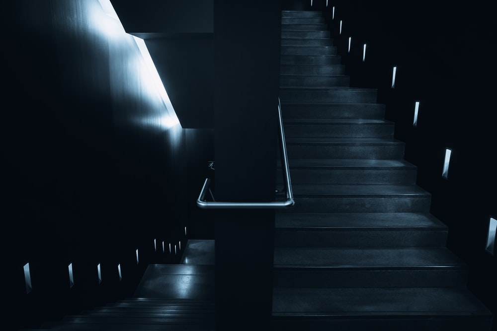 low-angle photography of stairs in dim light