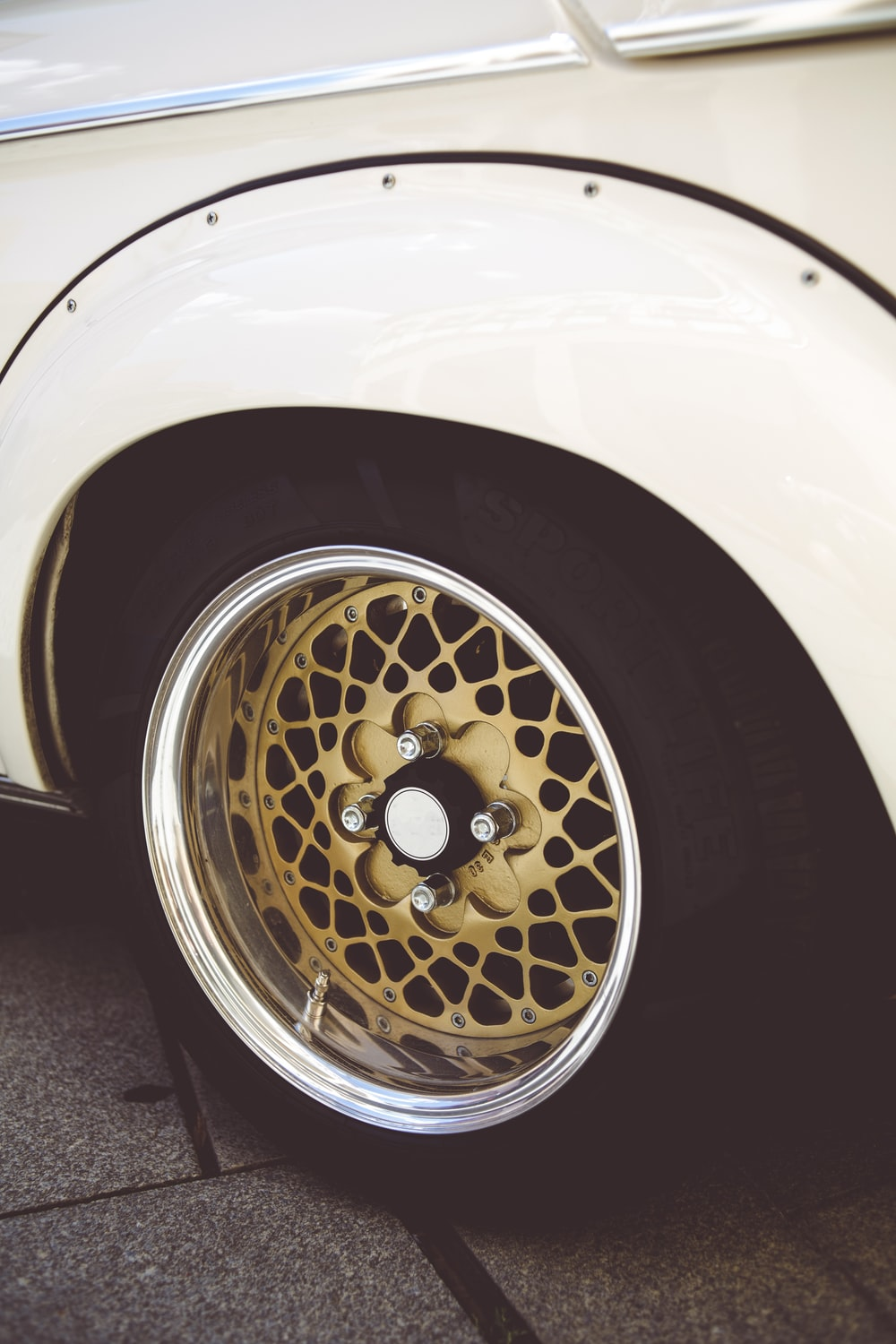silver and gold car wheel with tire