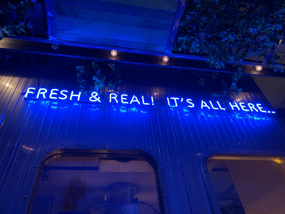 Fresh & Real! It's All Here...neon sign