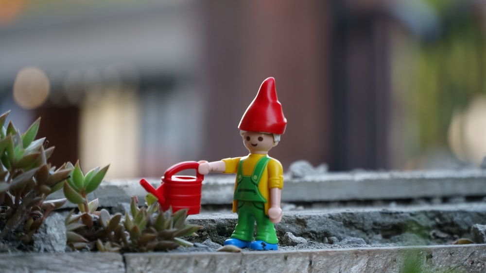 gnome holding watering can toy