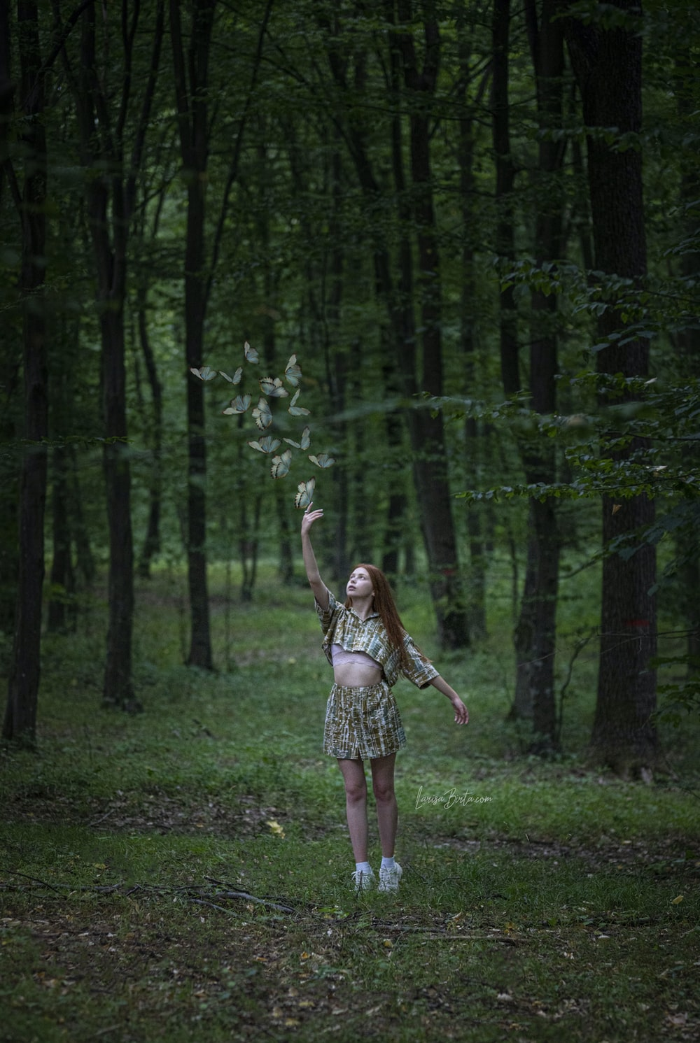 woman about to catch butterflies on forest