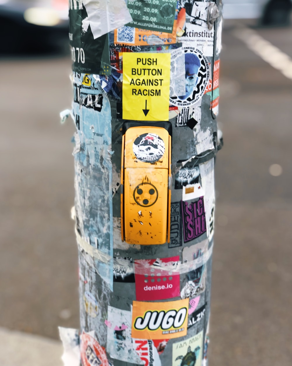 concrete post surrounded by posters