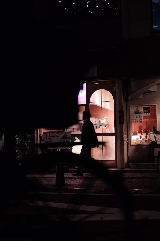 silhouette man waking black suit jacket
