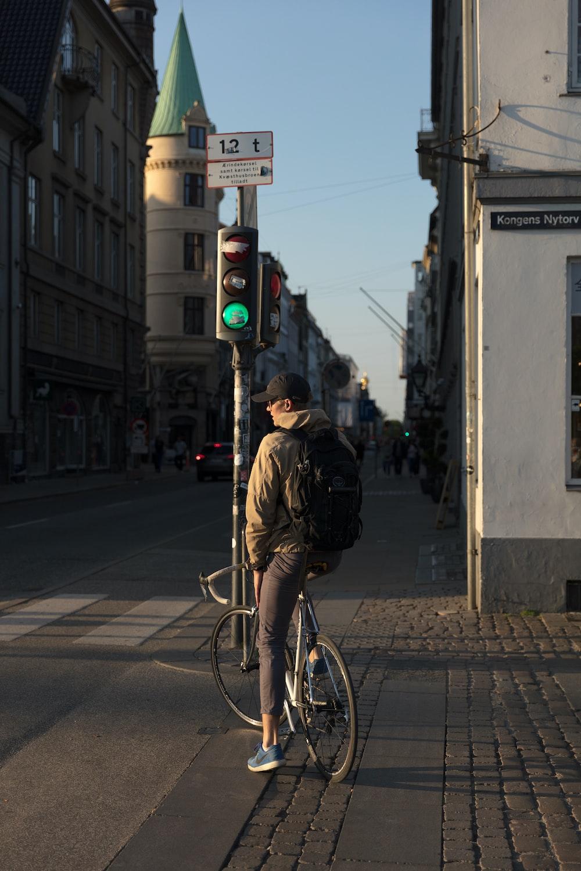 man riding bicycle near road