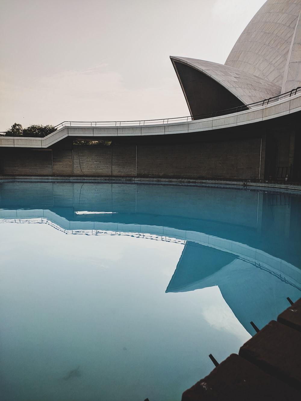 big blue swimming pool during daytime