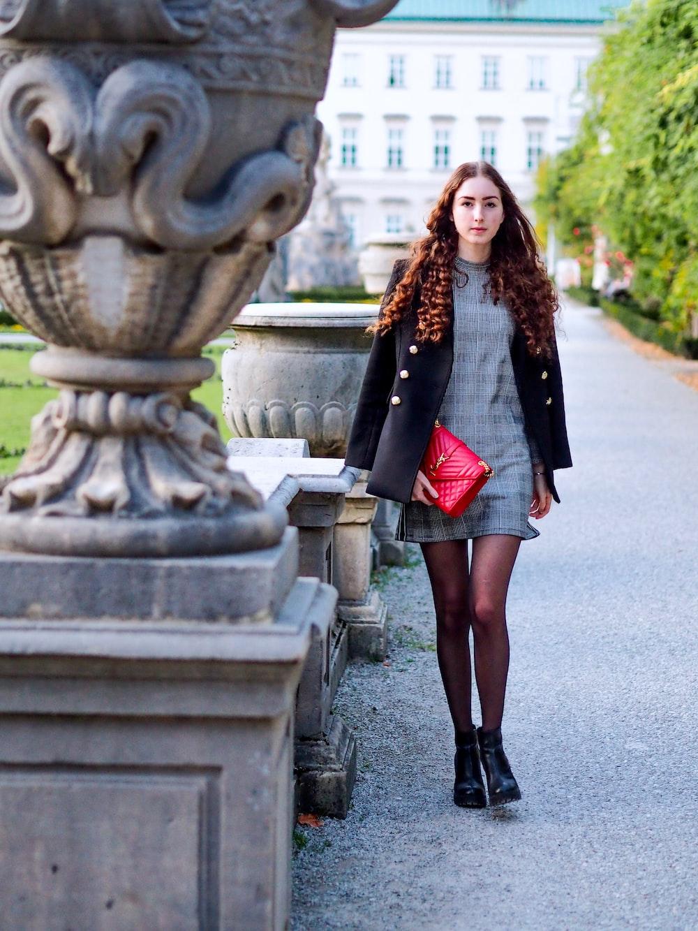 woman walking wearing black coat