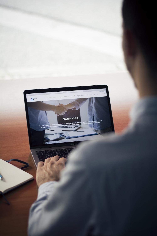 man operating the MacBook Pro