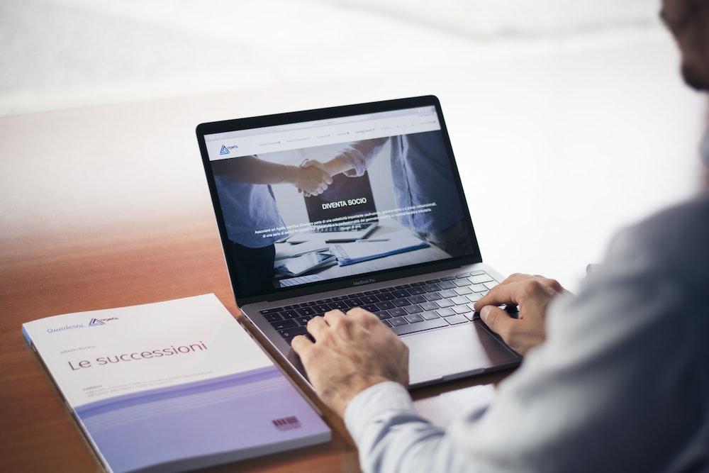 man's hands on MacBook Pro
