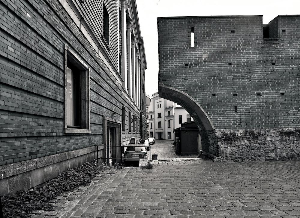 concrete building grayscale photo