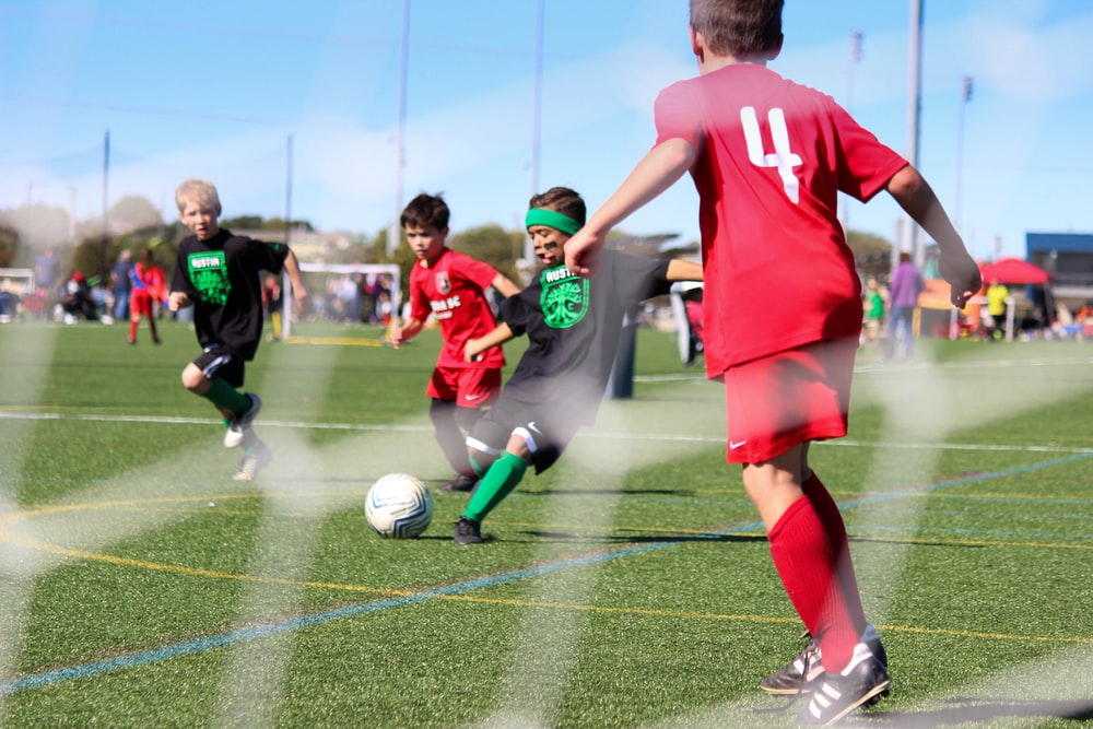 boy's playing soccer
