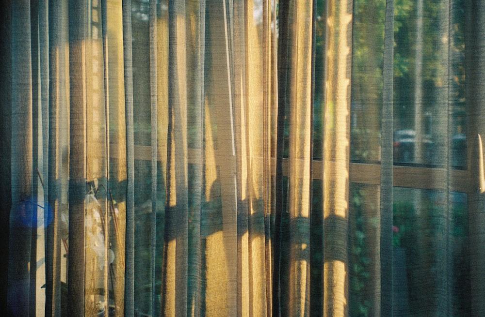 sunlight reflecting on yellow window curtain