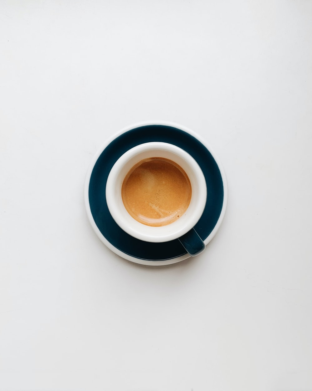 cup of coffee on top of saucer