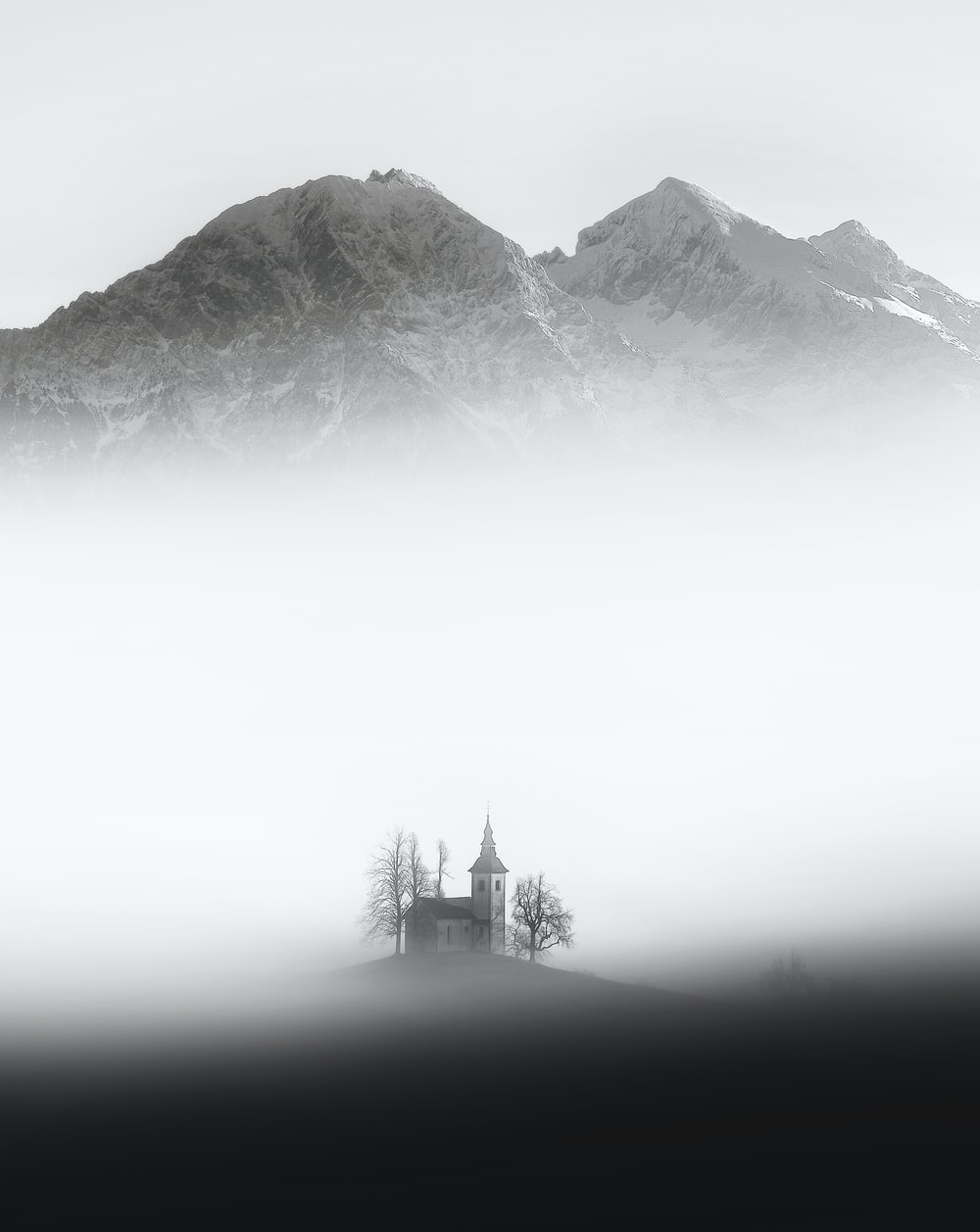 gray house surrounded by fog