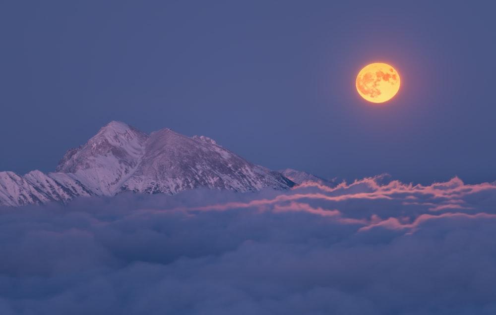 full moon under white skies